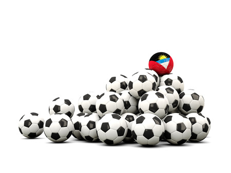 winning location: Pile of soccer balls with flag of antigua and barbuda. 3D illustration