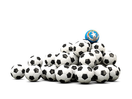 winning location: Pile of soccer balls with flag of northern mariana islands. 3D illustration