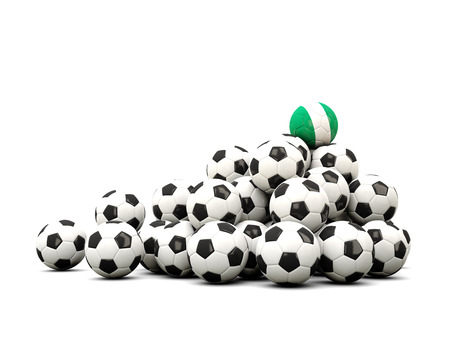 winning location: Pile of soccer balls with flag of nigeria. 3D illustration Stock Photo