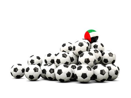 winning location: Pile of soccer balls with flag of united arab emirates. 3D illustration