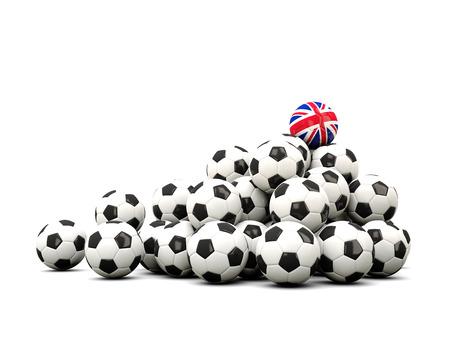 winning location: Pile of soccer balls with flag of united kingdom. 3D illustration