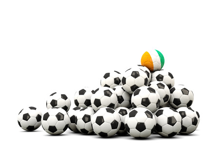 cote ivoire: Pile of soccer balls with flag of cote d Ivoire. 3D illustration Stock Photo