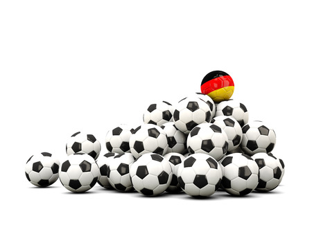 winning location: Pile of soccer balls with flag of germany. 3D illustration