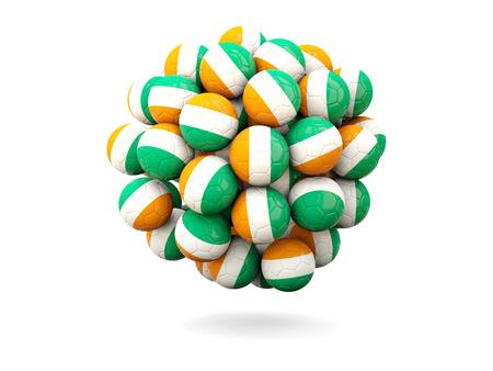 cote d ivoire: Pile of footballs with flag of cote d Ivoire. 3D illustration