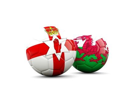 northern ireland: Northern Ireland and Wales soccer balls isolated on white. 3D illustration Stock Photo