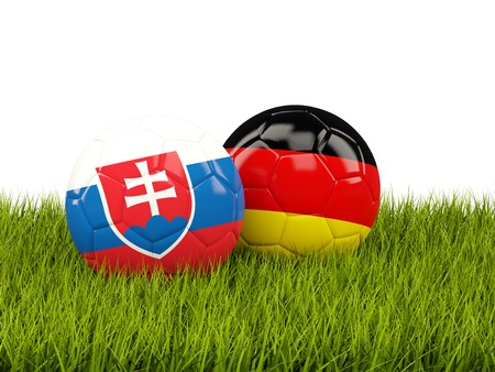 playoff: Germany and Slovakia soccer balls on grass. 3D illustration