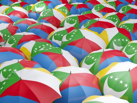 Flag of comoros on umbrella. 3D illustration