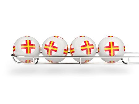guernsey: Flag of guernsey on lottery balls. 3D illustration