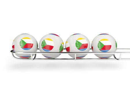 Flag of comoros on lottery balls. 3D illustration