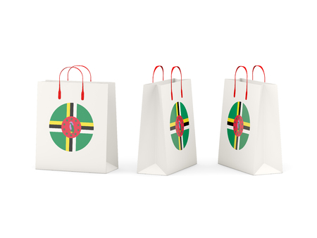 dominica: Round flag of dominica on shopping bags. 3D illustration