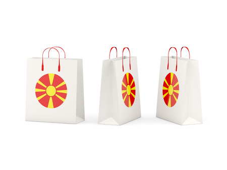 Round flag of macedonia on shopping bags. 3D illustration Stock Photo