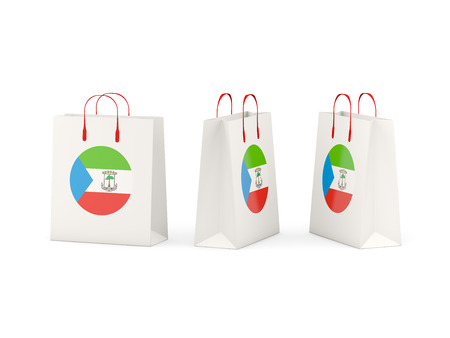 equatorial guinea: Round flag of equatorial guinea on shopping bags. 3D illustration Stock Photo