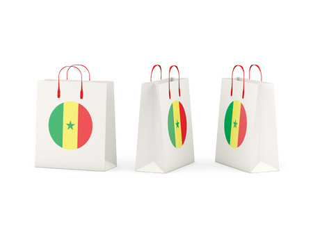 shoping: Round flag of senegal on shopping bags. 3D illustration Stock Photo