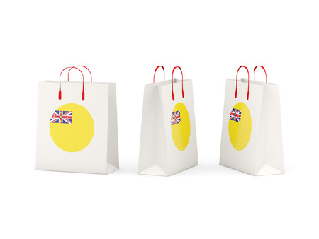 niue: Round flag of niue on shopping bags. 3D illustration Stock Photo