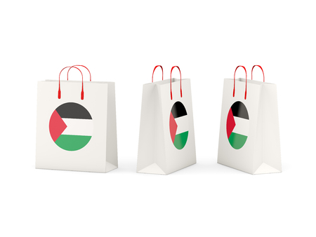 palestinian: Round flag of palestinian territory on shopping bags. 3D illustration