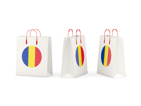 shoping bag: Round flag of romania on shopping bags. 3D illustration Stock Photo