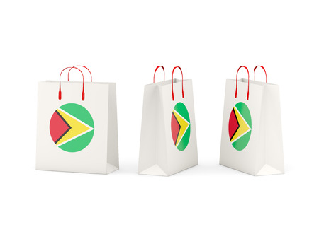 shoping bag: Round flag of guyana on shopping bags. 3D illustration