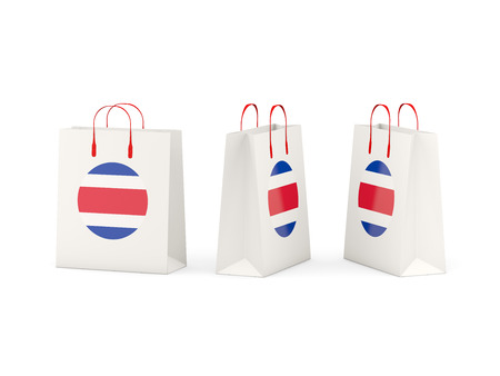 costa rica: Round flag of costa rica on shopping bags. 3D illustration