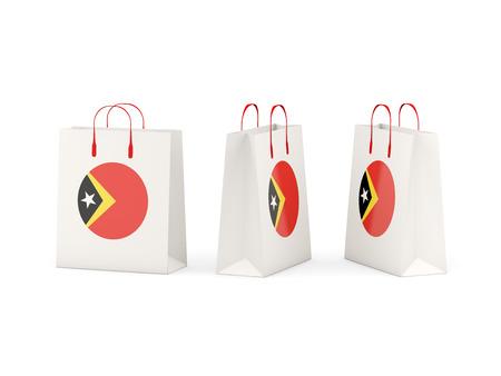 shoping bag: Round flag of east timor on shopping bags. 3D illustration Stock Photo