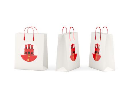 shoping bag: Round flag of gibraltar on shopping bags. 3D illustration
