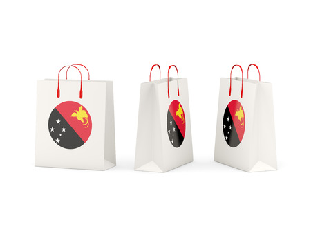 shoping bag: Round flag of papua new guinea on shopping bags. 3D illustration