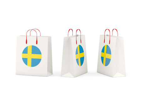 shoping bag: Round flag of sweden on shopping bags. 3D illustration