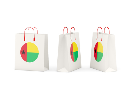guinea bissau: Round flag of guinea bissau on shopping bags. 3D illustration