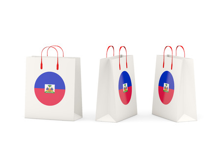 shoping bag: Round flag of haiti on shopping bags. 3D illustration Stock Photo