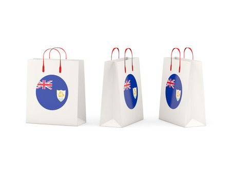 anguilla: Round flag of anguilla on shopping bags. 3D illustration