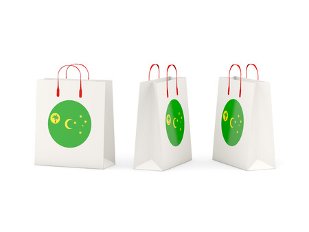 cocos: Round flag of cocos islands on shopping bags. 3D illustration