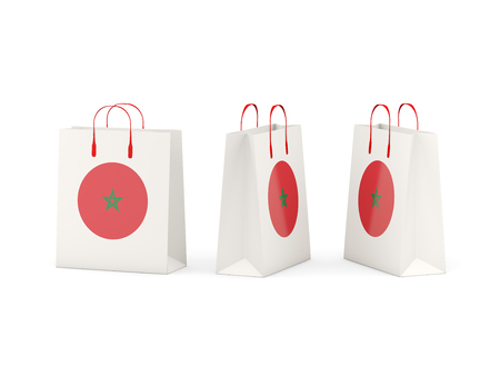 Round flag of morocco on shopping bags. 3D illustration
