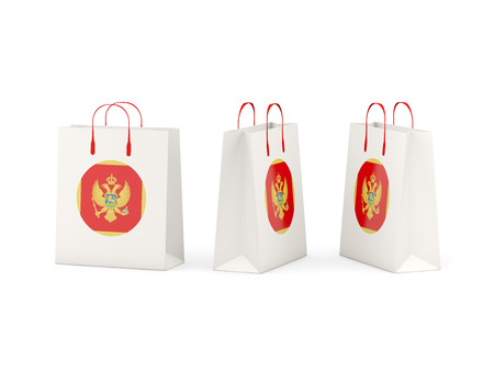 Round flag of montenegro on shopping bags. 3D illustration