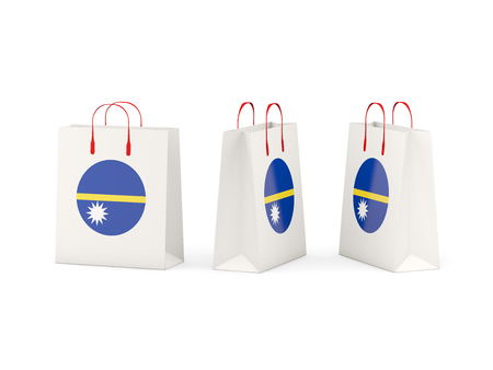 nauru: Round flag of nauru on shopping bags. 3D illustration Stock Photo