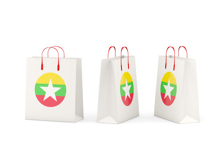 shoping: Round flag of myanmar on shopping bags. 3D illustration
