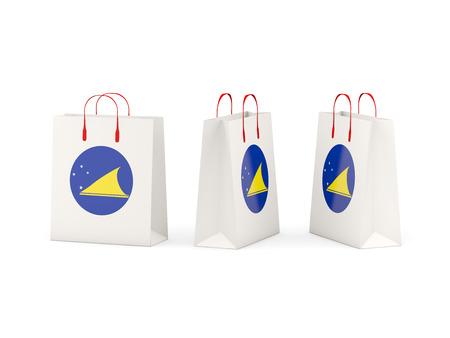 tokelau: Round flag of tokelau on shopping bags. 3D illustration
