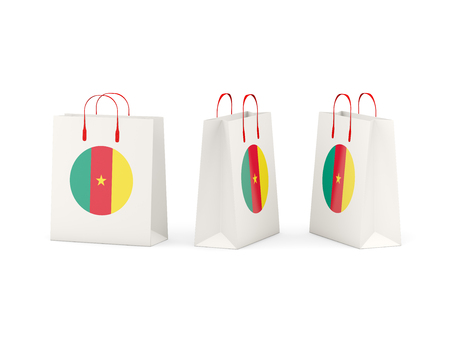 shoping bag: Round flag of cameroon on shopping bags. 3D illustration