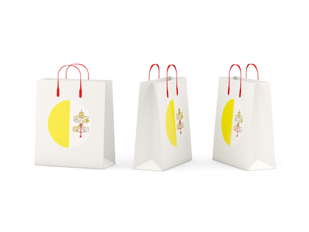 vatican city: Round flag of vatican city on shopping bags. 3D illustration