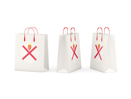Round flag of jersey on shopping bags. 3D illustration Stock Photo