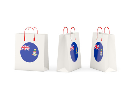 cayman islands: Round flag of cayman islands on shopping bags. 3D illustration