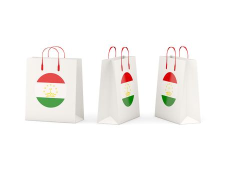 tajikistan: Round flag of tajikistan on shopping bags. 3D illustration