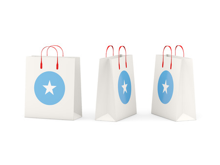 shoping: Round flag of somalia on shopping bags. 3D illustration