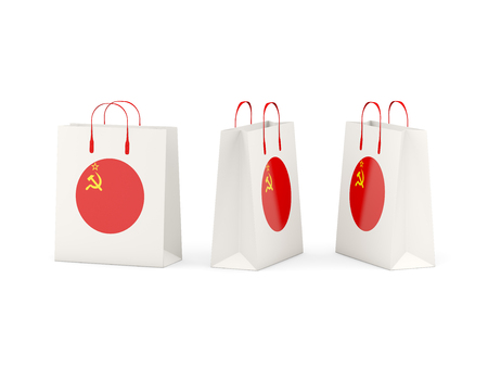 the ussr: Round flag of ussr on shopping bags. 3D illustration