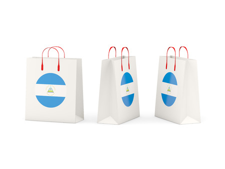 shoping bag: Round flag of nicaragua on shopping bags. 3D illustration