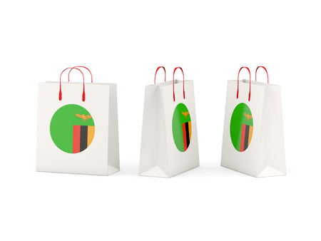 shoping bag: Round flag of zambia on shopping bags. 3D illustration Stock Photo