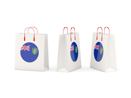 pitcairn: Round flag of pitcairn islands on shopping bags. 3D illustration