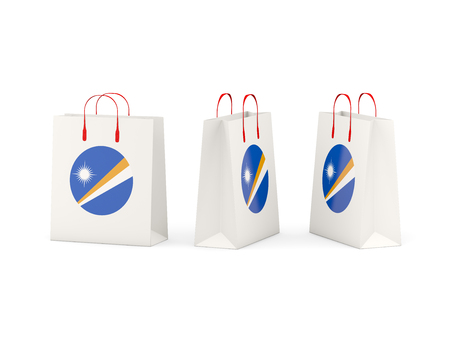 marshall: Round flag of marshall islands on shopping bags. 3D illustration Stock Photo
