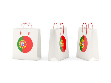 shoping bag: Round flag of portugal on shopping bags. 3D illustration Stock Photo