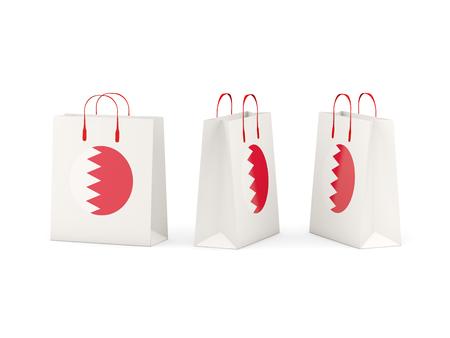 Round flag of bahrain on shopping bags. 3D illustration Stock Photo