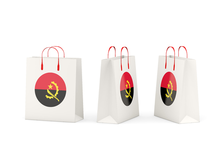 shoping bag: Round flag of angola on shopping bags. 3D illustration