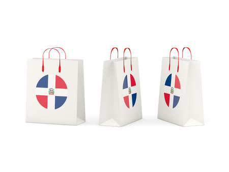 dominican republic: Round flag of dominican republic on shopping bags. 3D illustration